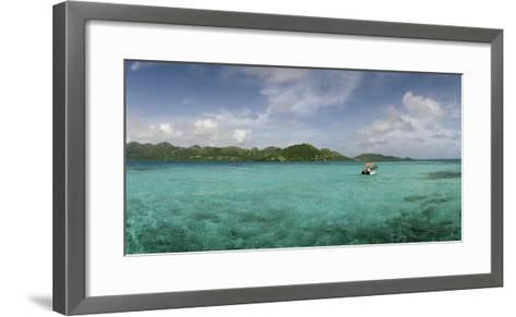 An Outboard Motorboat Adrift in the Clear Blue Water Off Crab Caye-Macduff Everton-Framed Art Print