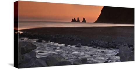 Reynisdrangar Basalt Sea Stacks, Near Vik, at Sunset-Raul Touzon-Stretched Canvas Print