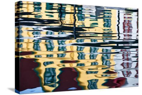 Buildings Reflected in Ripples in a Harbor-Karine Aigner-Stretched Canvas Print