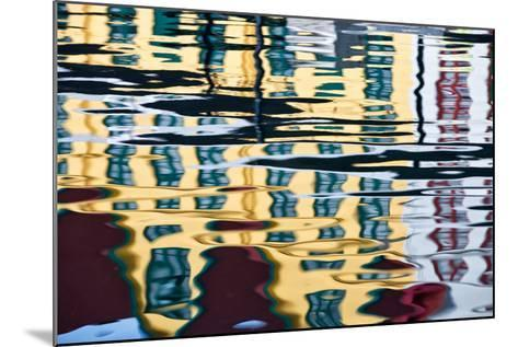 Buildings Reflected in Ripples in a Harbor-Karine Aigner-Mounted Photographic Print