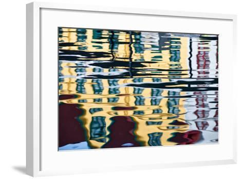 Buildings Reflected in Ripples in a Harbor-Karine Aigner-Framed Art Print