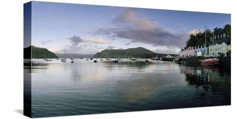At Portree's Harbor, Colorful Buildings Line the Quay and Boats Drift at Anchor-Macduff Everton-Stretched Canvas Print