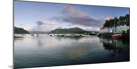 At Portree's Harbor, Colorful Buildings Line the Quay and Boats Drift at Anchor-Macduff Everton-Mounted Photographic Print