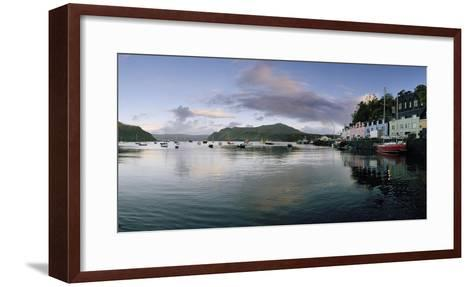 At Portree's Harbor, Colorful Buildings Line the Quay and Boats Drift at Anchor-Macduff Everton-Framed Art Print