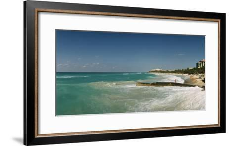 A Woman Standing on a Jetty as the Sea Rolls in around Her-Macduff Everton-Framed Art Print