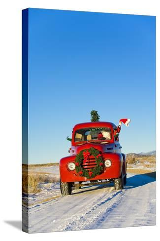Santa Driving a Vintage Red Ford Pick-Up Truck Down a Snowcovered Rural Road-Design Pics Inc-Stretched Canvas Print