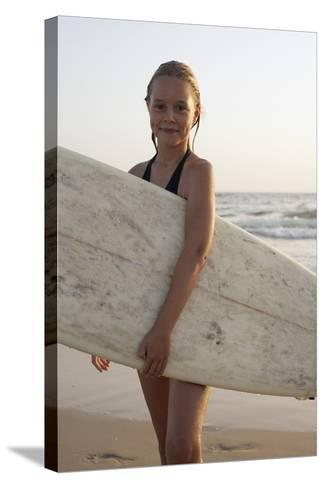 Young Girl with Surfboard-Design Pics Inc-Stretched Canvas Print