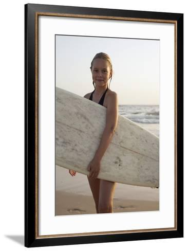 Young Girl with Surfboard-Design Pics Inc-Framed Art Print