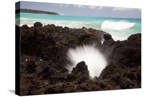 Hawaii, Maui, La Perouse Bay, a Burst of Water Through a Blowhole in Some Lava Rocks-Design Pics Inc-Stretched Canvas Print