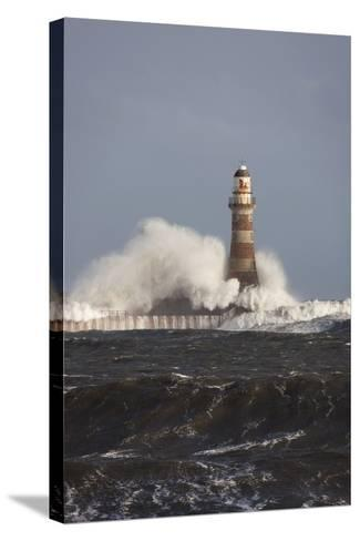 Waves Crashing Against a Lighthouse; Sunderland, Tyne and Wear, England-Design Pics Inc-Stretched Canvas Print