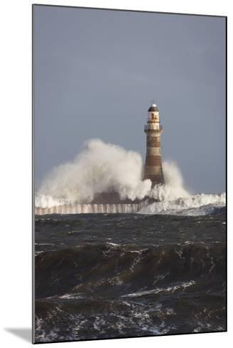 Waves Crashing Against a Lighthouse; Sunderland, Tyne and Wear, England-Design Pics Inc-Mounted Photographic Print