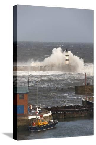Seaham, Teesside, England; Waves Crashing into a Lighthouse and a Boat Along the Pier-Design Pics Inc-Stretched Canvas Print