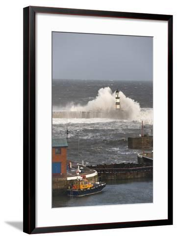 Seaham, Teesside, England; Waves Crashing into a Lighthouse and a Boat Along the Pier-Design Pics Inc-Framed Art Print