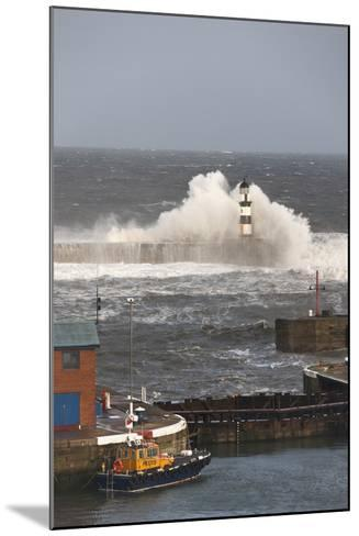 Seaham, Teesside, England; Waves Crashing into a Lighthouse and a Boat Along the Pier-Design Pics Inc-Mounted Photographic Print