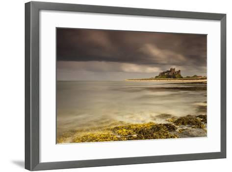 Bamburgh Castle under a Cloudy Sky; Bamburgh Northumberland England-Design Pics Inc-Framed Art Print