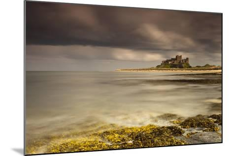 Bamburgh Castle under a Cloudy Sky; Bamburgh Northumberland England-Design Pics Inc-Mounted Photographic Print