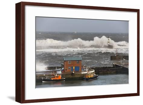 Seaham, Teesside, England; Waves Crashing into a Lighthouse and Boats Along a Pier-Design Pics Inc-Framed Art Print