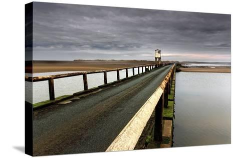 A Road Going over Water Towards a Beach; Northumberland,England-Design Pics Inc-Stretched Canvas Print