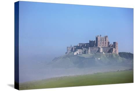 Bamburgh Castle in the Fog; Bamburgh Northumberland England-Design Pics Inc-Stretched Canvas Print