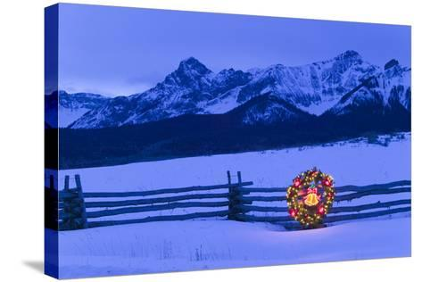 Split Rail Fence Decorated with Wreath and Christmas Tree Colorado Winter-Design Pics Inc-Stretched Canvas Print
