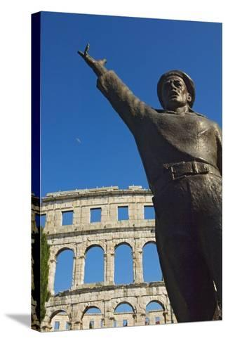 Bronze Statue in Front of Roman Amphitheater-Design Pics Inc-Stretched Canvas Print