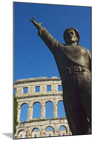 Bronze Statue in Front of Roman Amphitheater-Design Pics Inc-Mounted Photographic Print