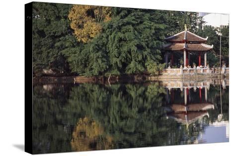 People Resting under Pagoda on Hoan Kiem Lake Shore-Design Pics Inc-Stretched Canvas Print