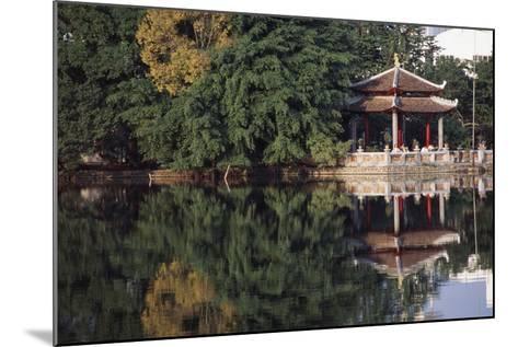 People Resting under Pagoda on Hoan Kiem Lake Shore-Design Pics Inc-Mounted Photographic Print