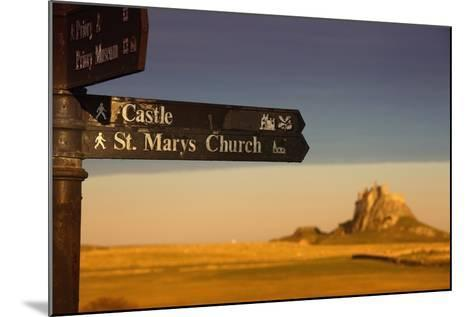 A Sign Post Pointing to a Castle and St. Marys Church on the Tidal Island-Design Pics Inc-Mounted Photographic Print