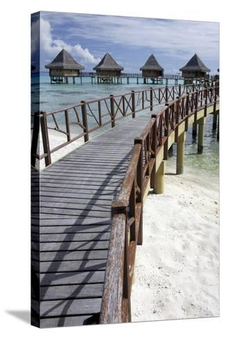 Walkway to Holiday Huts over Lagoon-Design Pics Inc-Stretched Canvas Print