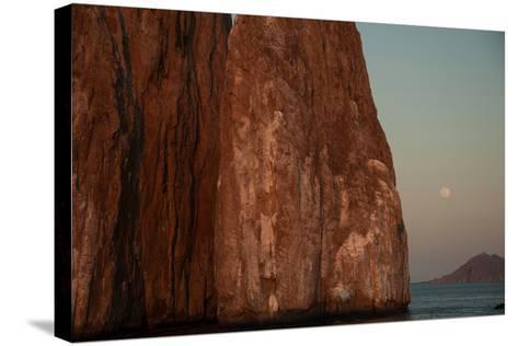 Moonrise Above Sleeping Lion Rock Off San Cristobal in the Galapagos-Karen Kasmauski-Stretched Canvas Print