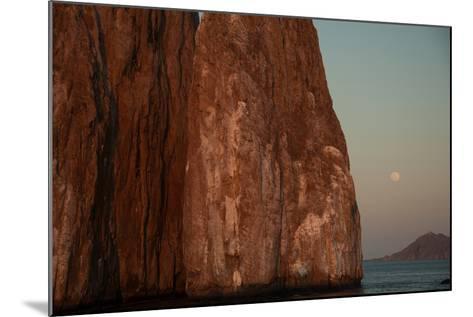 Moonrise Above Sleeping Lion Rock Off San Cristobal in the Galapagos-Karen Kasmauski-Mounted Photographic Print