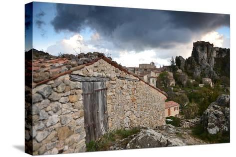 Stone Buildings Beneath Dark Clouds Near Verdon Gorge-Keith Ladzinski-Stretched Canvas Print