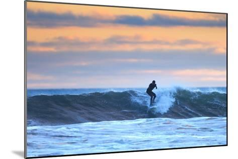 A Surfer Rides a Winter Wave Off the Coast of Maine at Sunset-Robbie George-Mounted Photographic Print