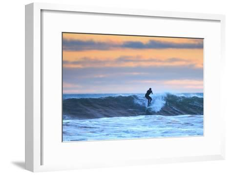 A Surfer Rides a Winter Wave Off the Coast of Maine at Sunset-Robbie George-Framed Art Print