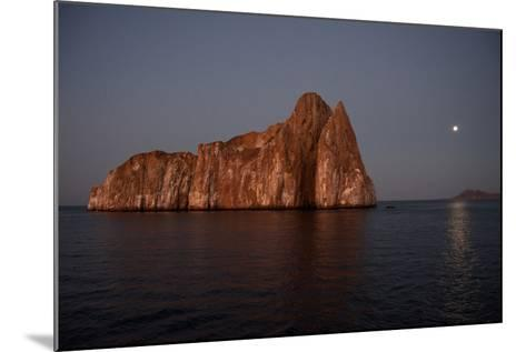 Sleeping Lion Rock Off San Cristobal in the Galapagos at Twilight-Karen Kasmauski-Mounted Photographic Print