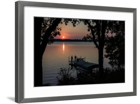 Residents Watch a Late Summer Sunset from their Dock on West Okoboji Lake-Kent Kobersteen-Framed Art Print