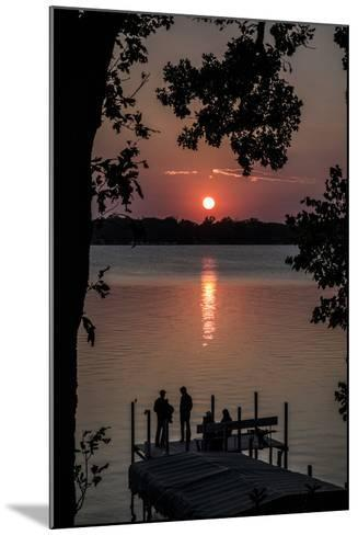Residents Watch a Late Summer Sunset from their Dock on West Okoboji Lake-Kent Kobersteen-Mounted Photographic Print