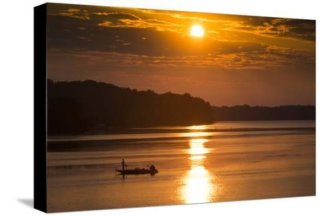 A Fisherman at Sunrise on the Occoquan River, Looking Toward Mason Neck-Kent Kobersteen-Stretched Canvas Print
