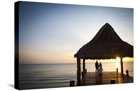 Newlyweds Watch the Sunset after their Beach Wedding on the West Coast of Cozumel Island-Michael Lewis-Stretched Canvas Print