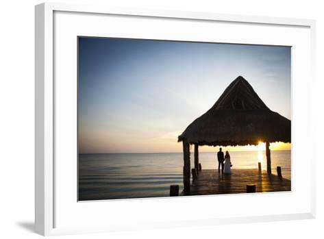 Newlyweds Watch the Sunset after their Beach Wedding on the West Coast of Cozumel Island-Michael Lewis-Framed Art Print