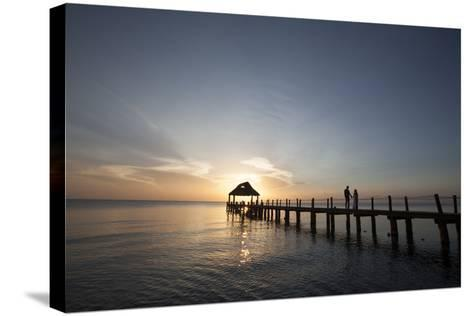 Newlyweds Walk Along a Pier on the West Coast of Cozumel Island-Michael and Jennifer Lewis-Stretched Canvas Print