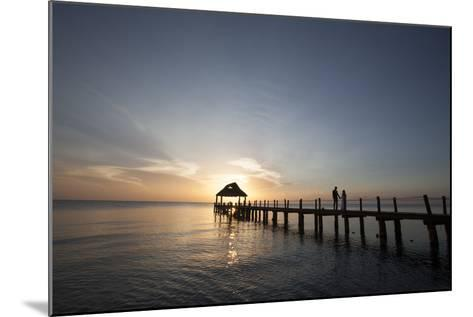 Newlyweds Walk Along a Pier on the West Coast of Cozumel Island-Michael and Jennifer Lewis-Mounted Photographic Print