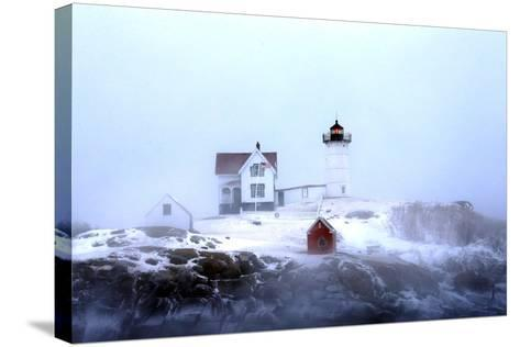Maine's Nubble Lighthouse Shines on a Cold Winter's Day-Robbie George-Stretched Canvas Print