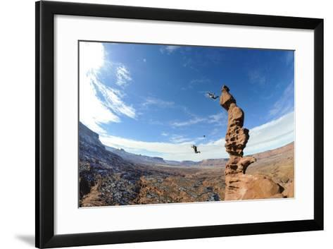 Two People Base Jump Off a Sandstone Spire at the Fisher Towers in Castle Valley, Utah-Keith Ladzinski-Framed Art Print