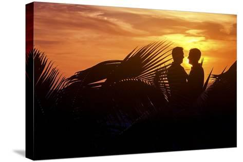 Two Men Embrace after their Beach Wedding in Mexico-Michael Lewis-Stretched Canvas Print