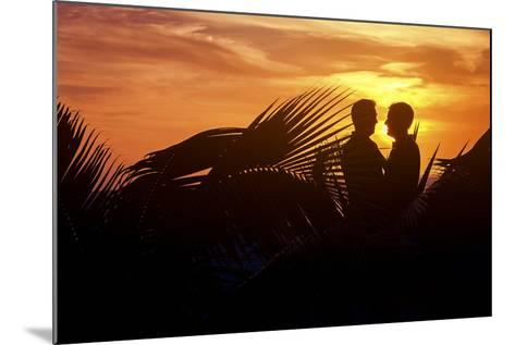 Two Men Embrace after their Beach Wedding in Mexico-Michael Lewis-Mounted Photographic Print