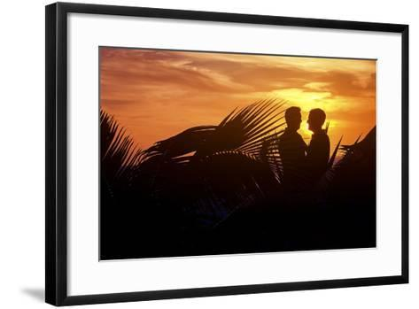 Two Men Embrace after their Beach Wedding in Mexico-Michael Lewis-Framed Art Print