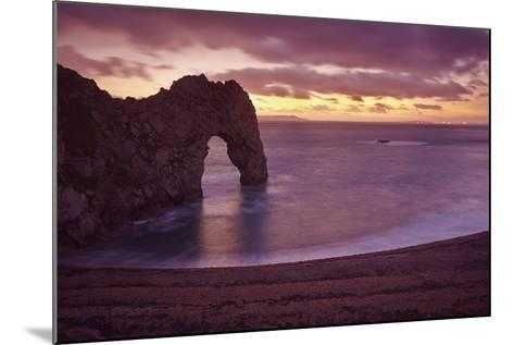 The Durdle Door Rock Arch at Dusk-Nigel Hicks-Mounted Photographic Print