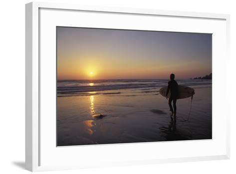 Silhouetted Surfer on Sandy Beach at Sunset-Design Pics Inc-Framed Art Print